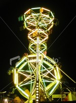Ist2_48840_carnival_ride_at_night